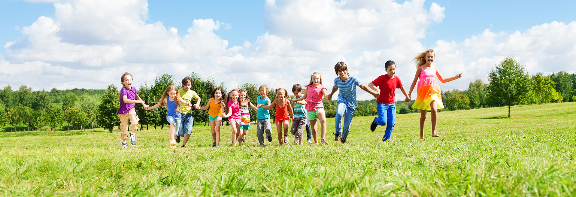 kids running in a field - Pediatric Dentist in San Angelo, TX